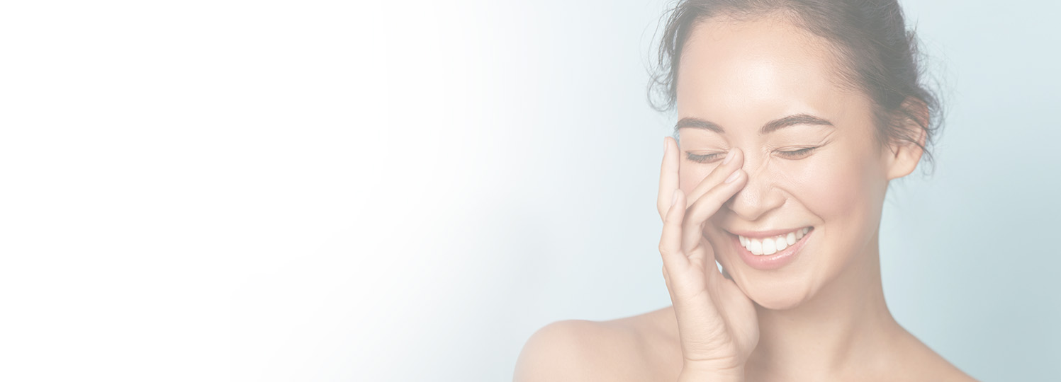 an image of a woman with her hand on her face